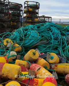 Crab pots, buoys, and rope on the pier at Girabaldi, Oregon.
