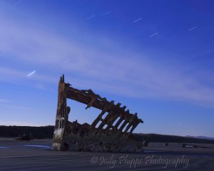 The remains of the Peter Iredale rest on the sands of Fort Stevens State Park.  This was taken at night under an almost full moon.