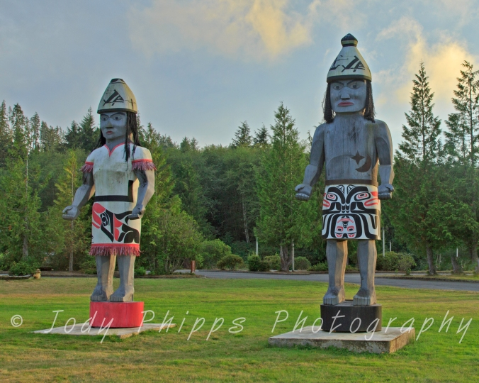 Wood carved totems at the entrance to the Makah Cultural