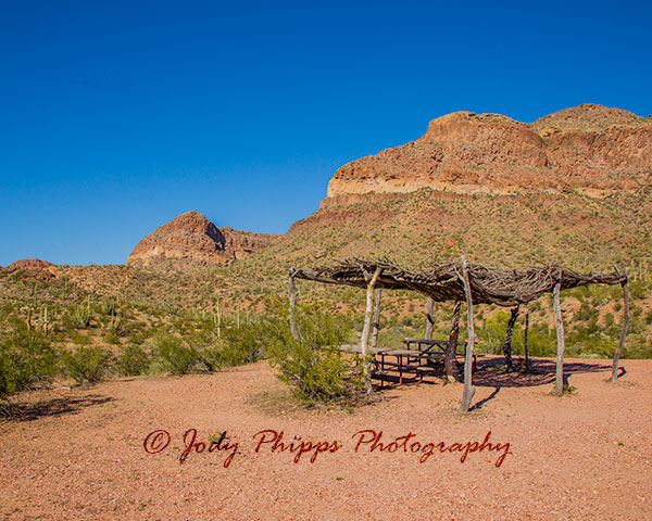 A Ramada made from Ocotillo branches shelters a picnic table along the Ajo Mountain Drive.