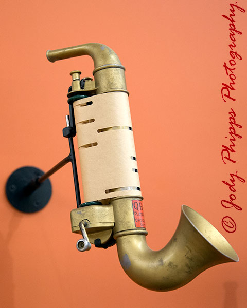 A Playasax (mechanical mouth organ) made by Q.R.S. DeVry Corp. and manufactured from the mid-1920s to the 1930s.