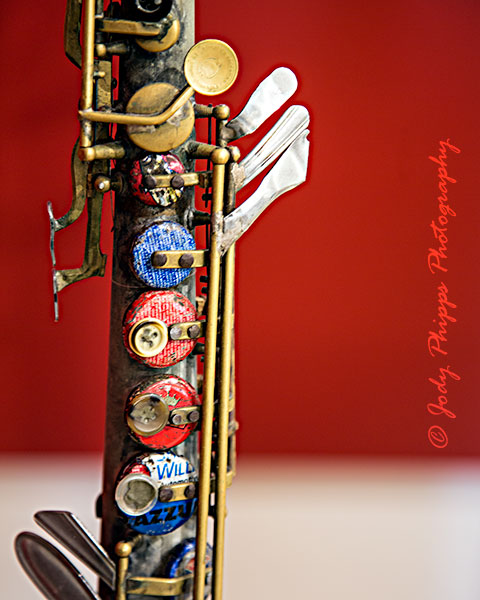 A soprano saxophone made from a tin water pipe, metal bottle caps, plastic buttons, metal spoon and fork handles from the Recycled Orchestra of Paraguay.